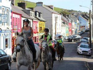Horse riding through Dingle Town